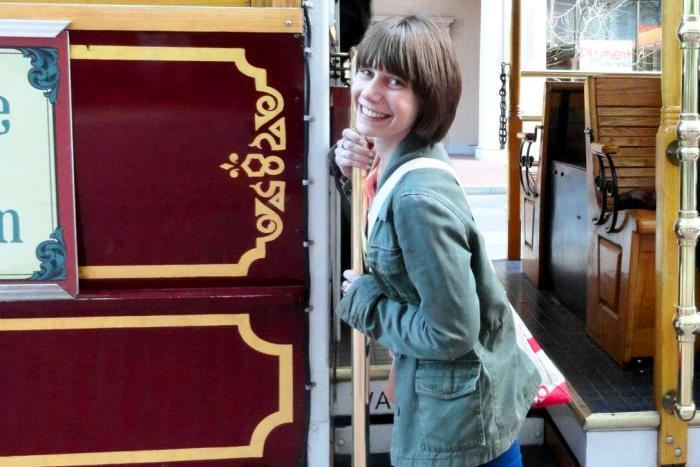 miriam weiner rides a trolley in San Francisco.