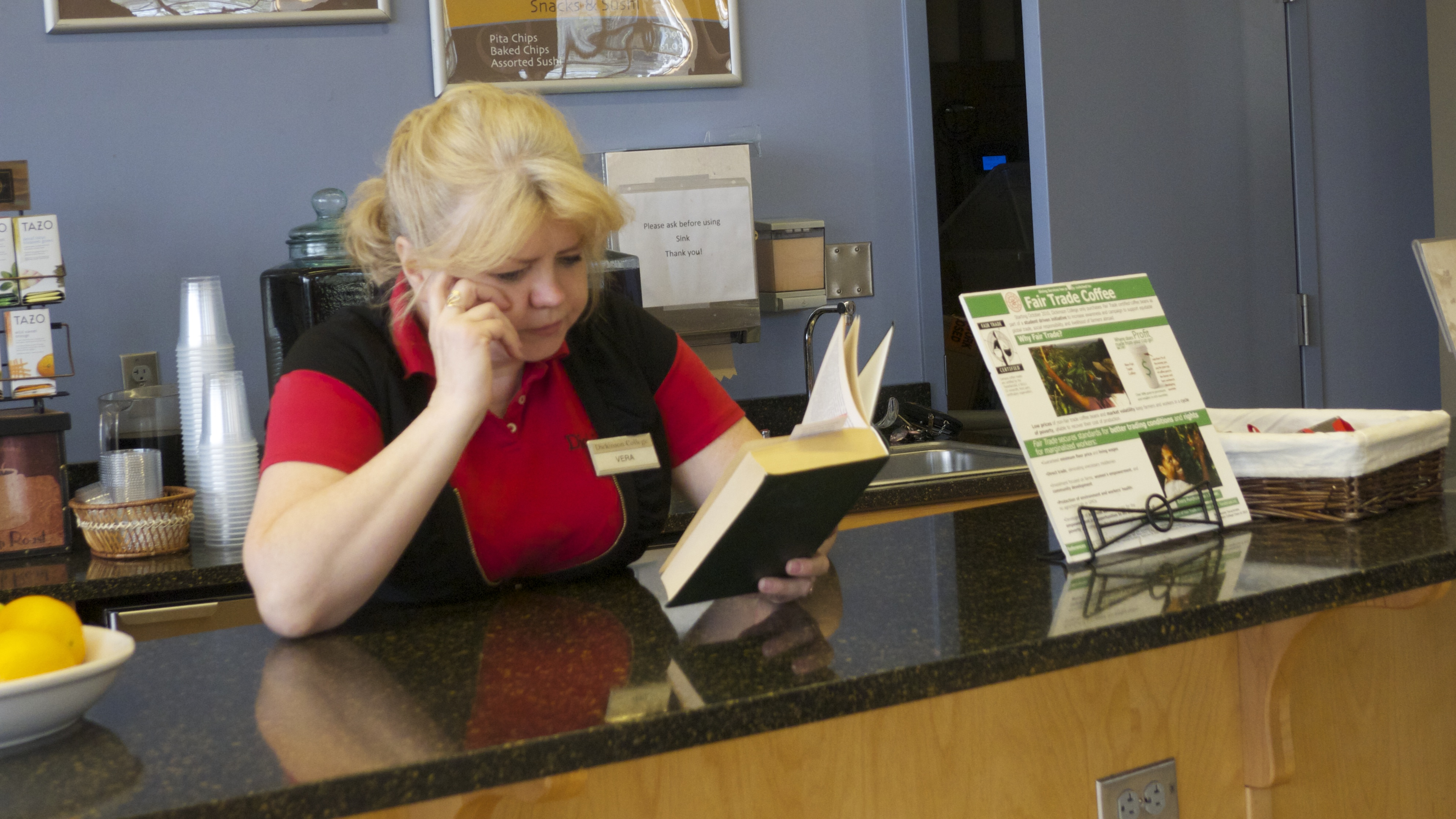 A Dining Services employee brushes up on her Russian Don Quixote at the Biblio Café.
