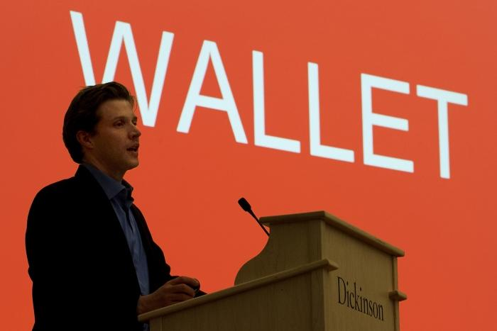 Alec Ross takes to the podium to discuss bitcoin.