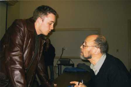 Lucas Stratton, class of 2004, speaks with Dmitri Prigov during autograph signing.