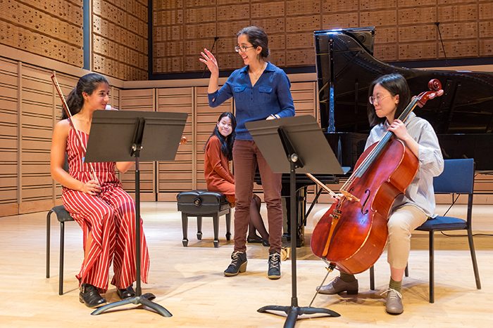 Ana María Otamendi of the Reveron Piano Trio works with Dickinson student-musicians Elisa Varlotta '20 (violin), Yiran Ying '20 (cello) and Ruby Ngo '22 (piano).