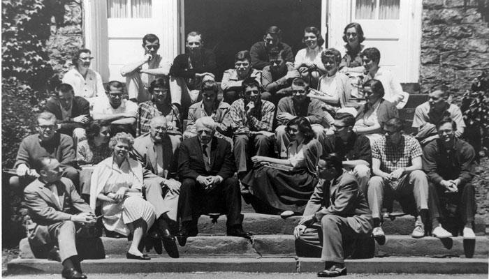 robert frost on the steps of Old West with students