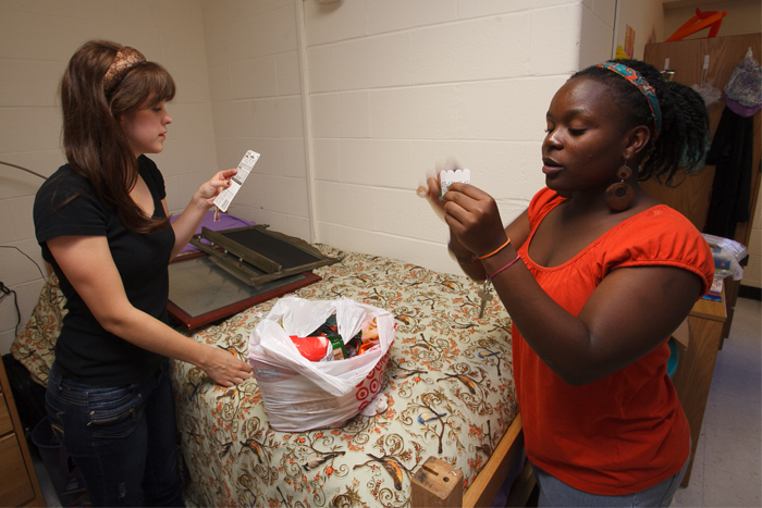 First-year roommates decorate their dorm room.