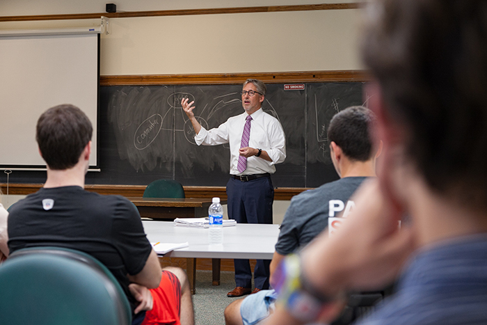 Brett Jenks, recipient of the 2017 Rose-Walters Prize for Global Environmental Activism, works with students in Professor of Political Science Jim Hoefler's senior seminar. Photo by Carl Socolow '77.