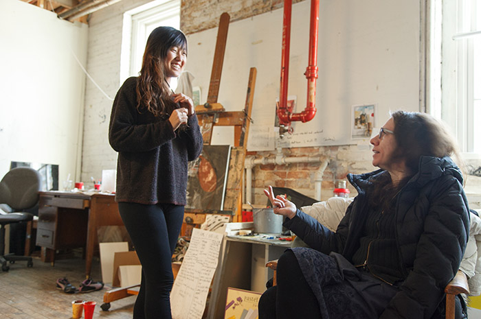 World-renowned artist Judith Schaecter discusses life and art with studio-art major Tesha Chai '14. Schaecter is one of nearly a dozen acclaimed artists, performers, musicians and writers who served residencies at Dickinson in 2013-14.
