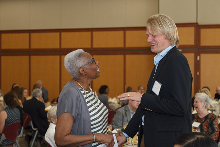 Froom greets Dean Joyce Bylander during the 2018 Scholarship Luncheon. Photo by Carl Socolow '77.