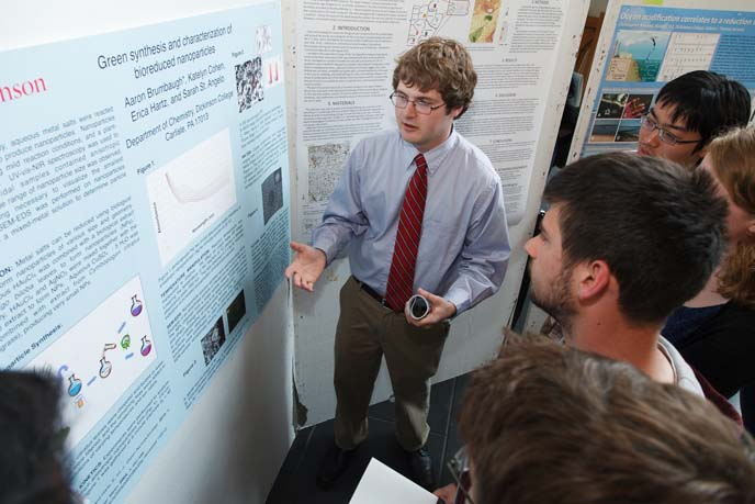 Aaron Brumbaugh explains original research during the 2013 Science Student Symposium.