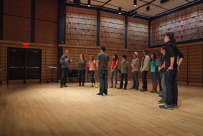 Tenor Markus Zapp (far left) of Singer Pur works with members of a student a cappella group during a masterclass on vocal technique.