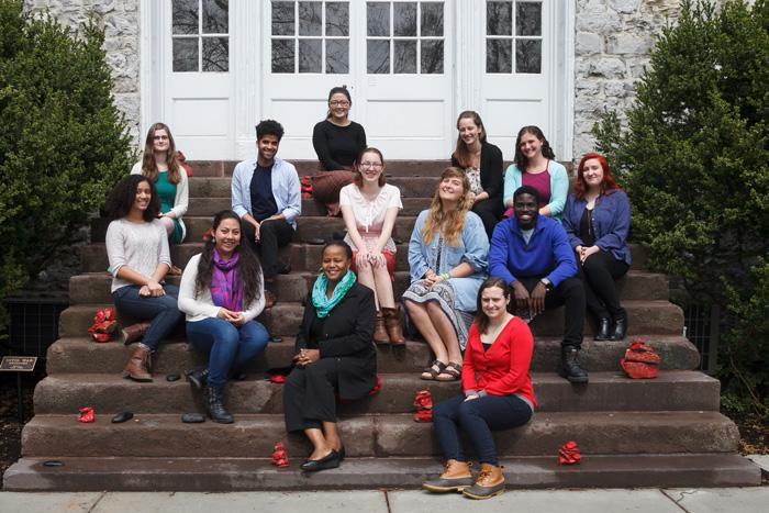 Students and Edwidge Dandicat pose on the steps of Old West