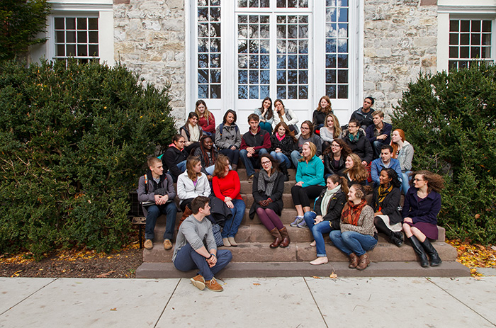 Lorrie Moore poses with students on the steps of Old West, the traditional Stellfox photo.