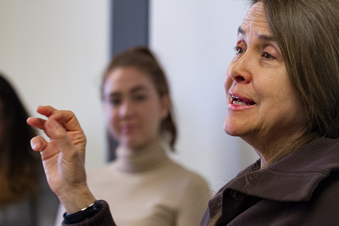 Poet Naomi Shihab Nye speaks with students studying literature, creative writing and cultural studies during her March 5-6 residency. Photo by Carl Socolow '77.