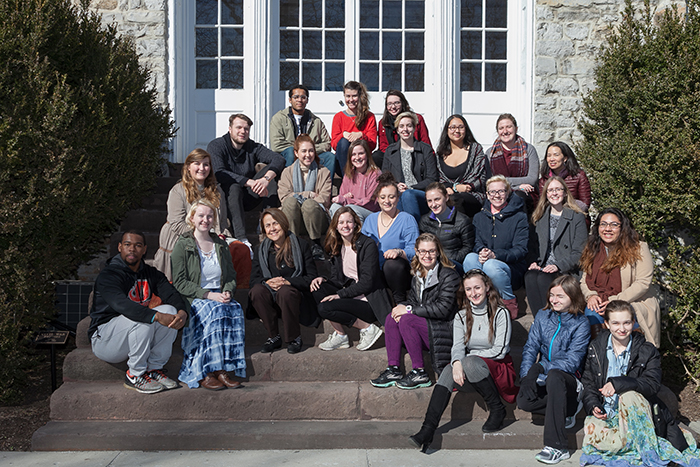 Naomi Shahib Nye poses with students in front of Old West, reenacting a 1959 photo shoot with Robert Frost. Photo by Carl Socolow '77.