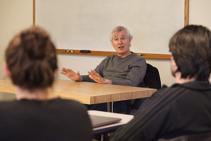 John Patrick Shanley speaks with students in a theatre class. Photo by Carl Socolow '77.