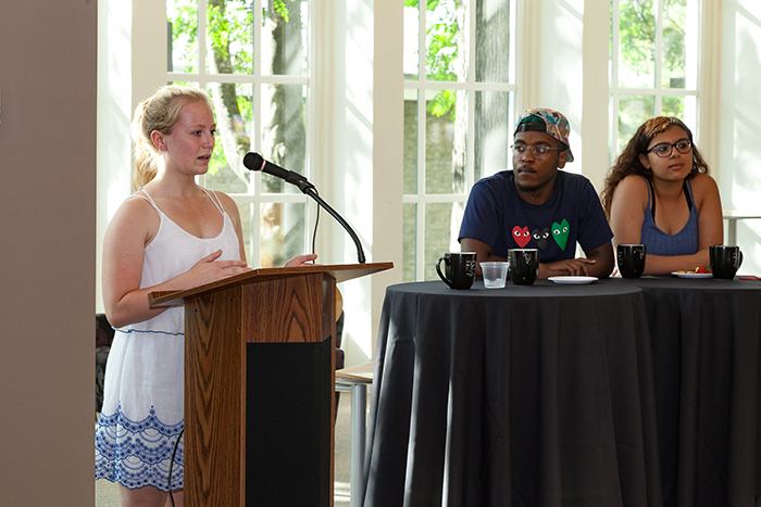 "From left: Meredith Johnson '18, Muhajir Lesure '20 and Carol Fadalla '18 discuss their summer research during the first ""Tea"" event of the semester."