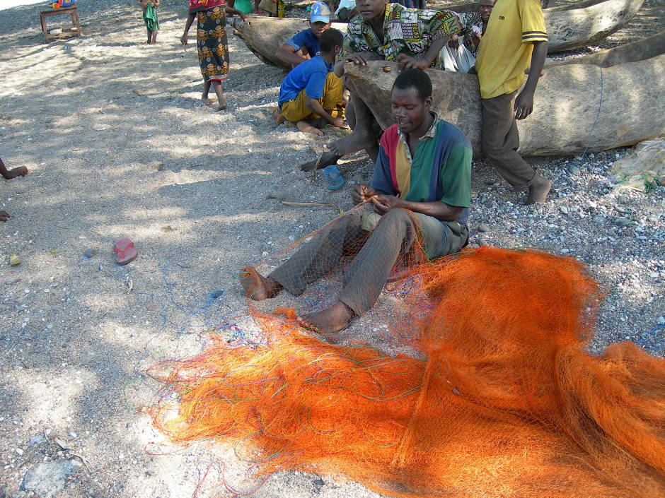 Photograph of Tanzania fishermen mending the nets