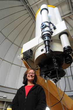 Photograph of Professor Hamilton-Drager in the Observatory beneath the telescope