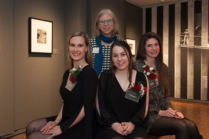 Senior art-history majors (front row, from left) Kate Marra, Monica Skelly and Jacqueline Hochheiser, with Associate Professor of Art History Elizabeth Lee (back row) on the exhibition's opening night.