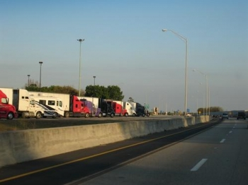 Photograph of I-81 with trucks at rest stop