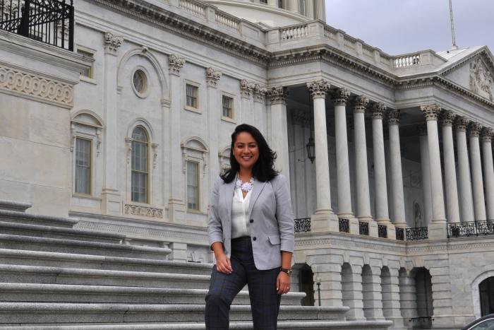 Valeria Carranza poses in from of a Congressional building in Washington DC