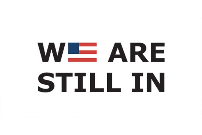 We Are Still In Logo