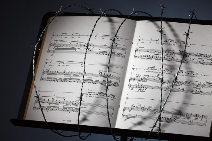 Sheet music in barb wire