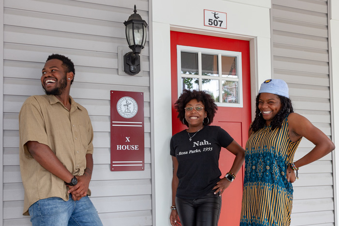 Quadrese Glass '19, Janaiya Banks '19 and Naji Thompson '19 pose in front of the special-interest house they co-founded. Five students are living in X House this semester. Photo by Carl Socolow '77.
