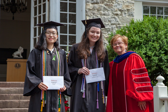 Moyi Tian '19, the James Fowler Rusling Prize winner, and Mary Katherine Levangie '19, the winner of the John Patton Memorial Prize for High Scholastic Standing, pose with Dickinson President Margee Ensign.