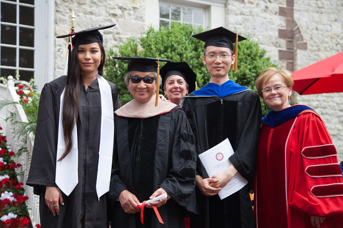 Adrian Zecha '52, who was was presented Doctor of International Business honorary degree, poses with his daughter, Adya Zecha; 