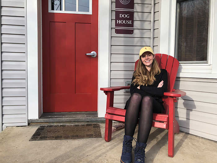 Abbie Cottle '20, in front of Dickinson's Dog House, where students train service animals.