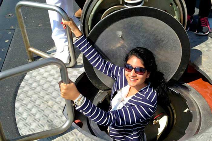Angeline Apostolou '15 climbs into a military submarine at a Greek naval base as part of a summer study-abroad excursion.