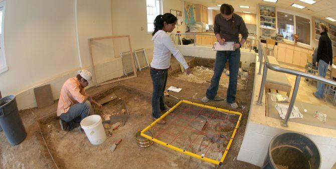 Students working on the dig simulator of the Keck Archaeology Lab