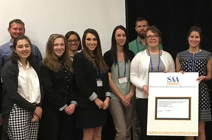 Makensie Jones '18 and Isabel Figueroa '19 (first row, first and second from left, respectively) pose after their presentation with fellow presenters and their professor, Maria Bruno (back row, second from left).