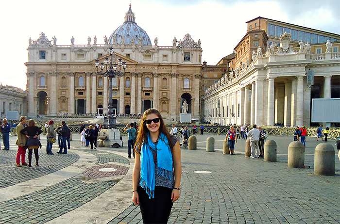 Ashton Fiucci '15 poses in Vatican City during a trip to Italy. She recently helped edit a new academic journal investigating gender in Italian culture.