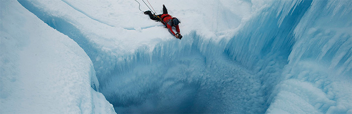photo of James Balog diving into glacier