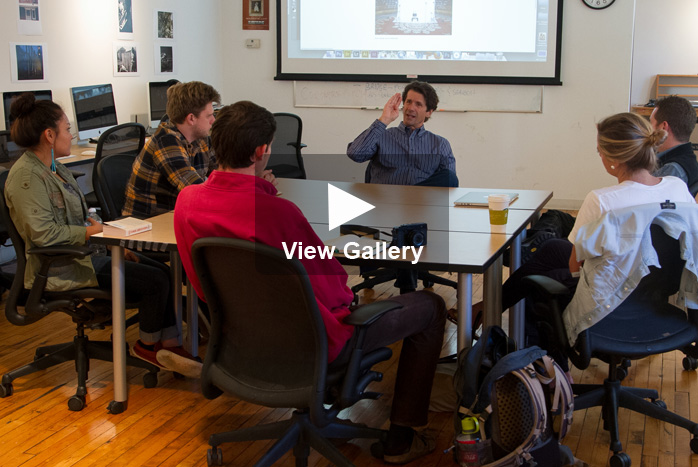 A photo of James Balog talking in students in class with