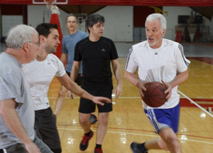 Faculty and staff playing basketball