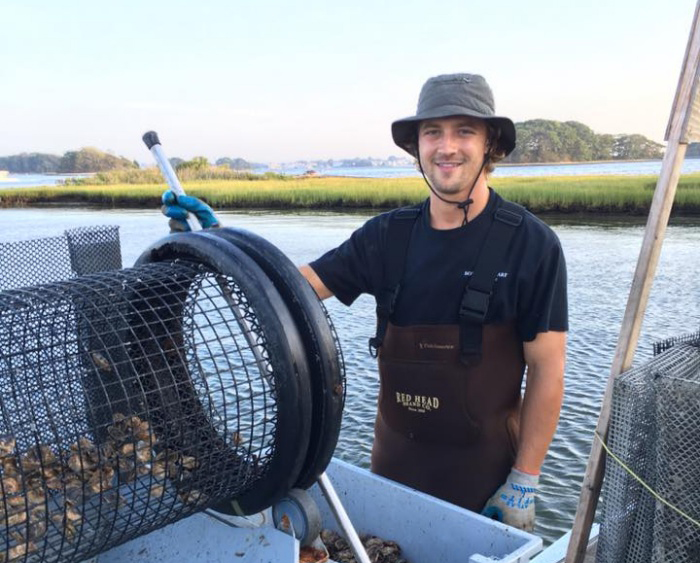 brad boehringer '13 at his oyster farm
