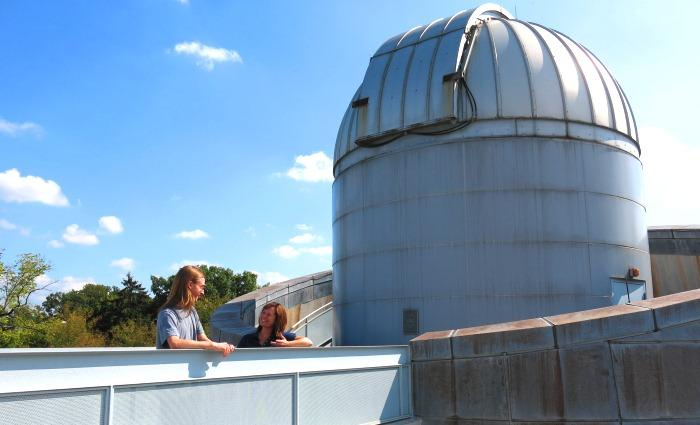 Ben Kimock and Catrina Hamilton-Drager take a break from their research outside the Britton Observatory.
