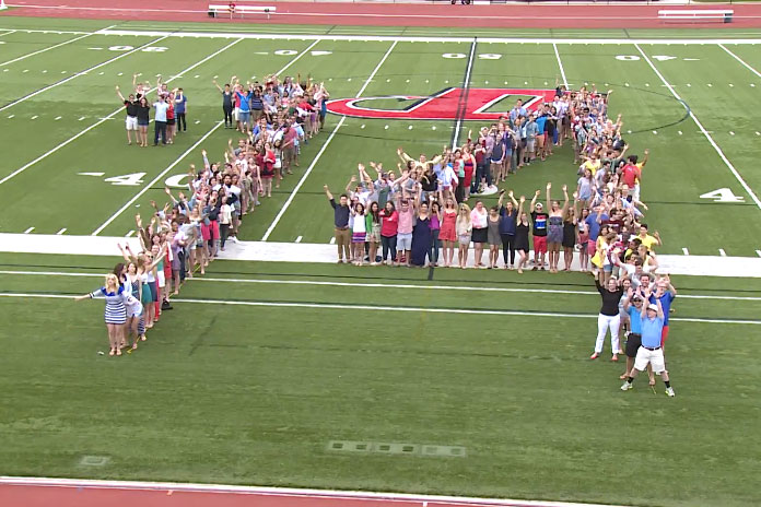 A group shot of class of 2014 Dickinson students spelling out '14.