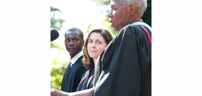 Jahmel Martin and Jessica Klimoff listen as Joyce Bylander introduces them during the Convocation ceremony.