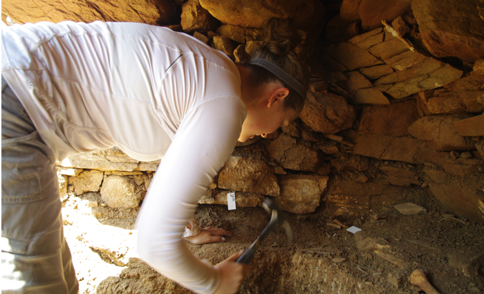 Archaeologist Allison Cuneo '07 excavates a tomb in the Sidekan area of Iraqi Kurdistan (July 2013).