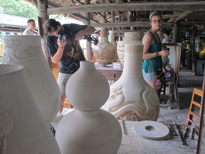 Joelle Cicak takes in the emerging porcelain vases.