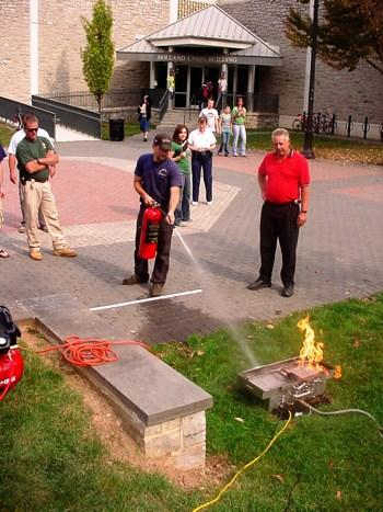 Testing a fire extinguisher during safety training.