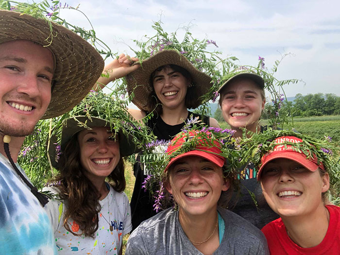 Student Farmers with leaves in their hats.