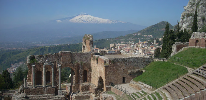 Visit this ancient Greek theater in Taormina with a view of Mt. Etna. © Łukasz Stachowiak
