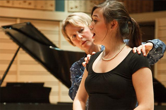 Associate Professor of Music Lynn Helding works with music major Holly Kelly '15.