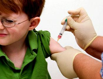 Photograph of child receiving a shot