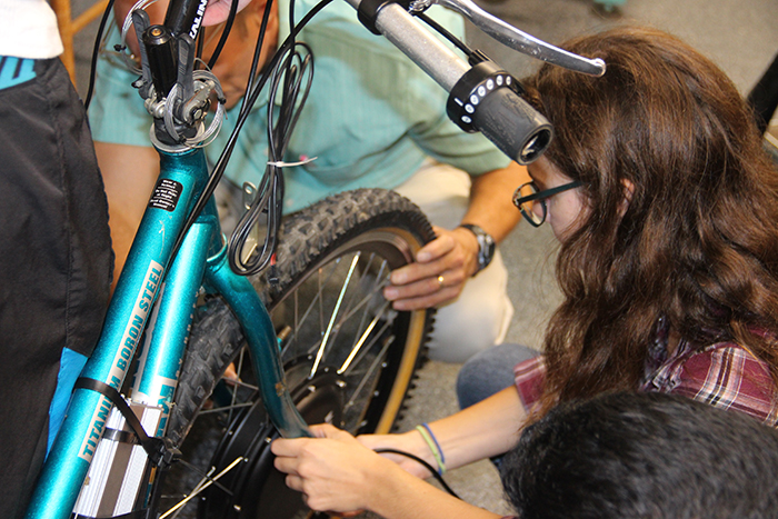 Rachel Krewson '20 works on an electronic bike.