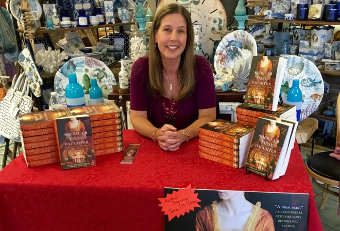 Laura Kamoie at a book signing event