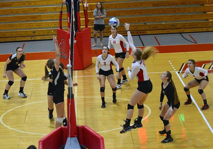 Lauren Beecher '18 (third from right) on the volleyball court.
